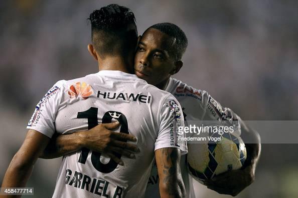 Robinho of Santos celebrates the second goal with Gabriel during the match between Santos and Cruzeiro for Copa do Brasil 2014 at Vila Belmiro...