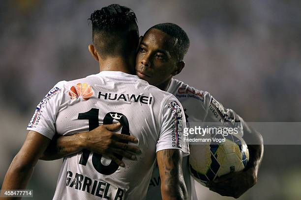 Robinho of Santos celebrates the second goal with Gabriel during the match between Santos and Cruzeiro for Copa do Brasil 2014 at Vila Belmiro...