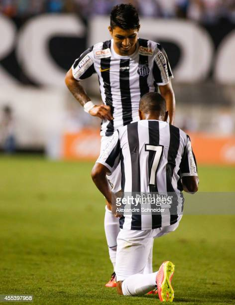 Robinho of Santos celebrates their second goal during the match between Santos and Coritiba for the Brazilian Series A 2014 at Vila Belmiro stadium...