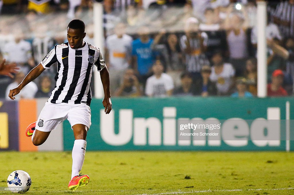 Robinho of Santos scores their second goal during the match between Santos and Coritiba for the Brazilian Series A 2014 at Vila Belmiro stadium on...