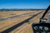 Robinson 22 helicopter comes in for a landing at Sonoma County's Charles M Schulz Airport on June 18 near Santa Rosa California The airport is...