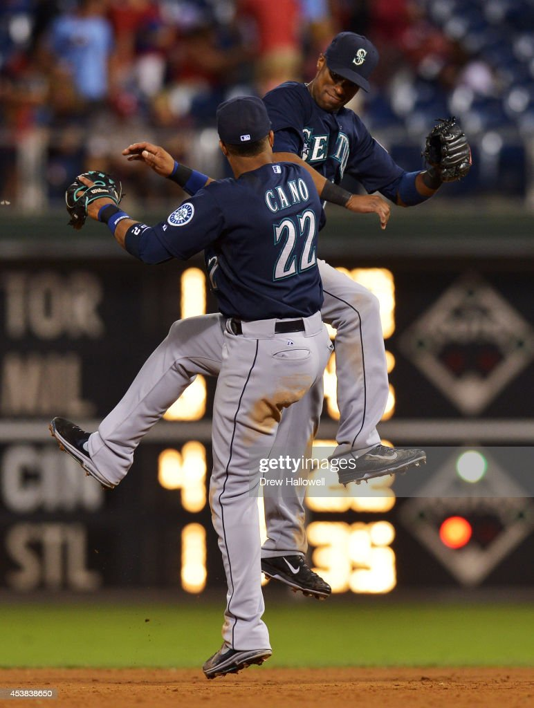 Robinson Cano #22 and Austin Jackson #16 of the Seattle Mariners celebrate a 5-2 win over the Philadelphia Phillies at Citizens Bank Park on August 19, 2014 in Philadelphia, Pennsylvania.