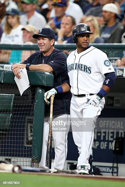 Robinson Cano and Edgar Martinez of the Seattle Mariners look on during the game against the Detroit Tigers at Safeco Field on July 7 2015 in Seattle...