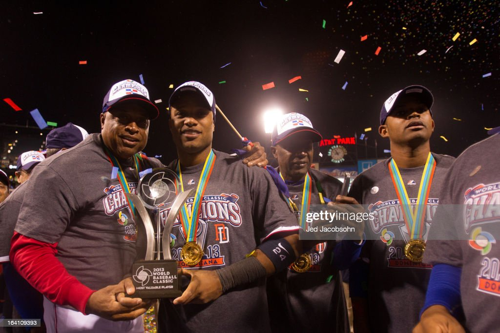 Robinson Cano #24 and his father and bullpen coach Jose Cano #70 of Team Dominican Republic pose with the MVP trophy after the 2013 World Baseball Classic Championship Game against Team Puerto Rico on Tuesday, March 19, 2013 at AT&T Park in San Francisco, California.
