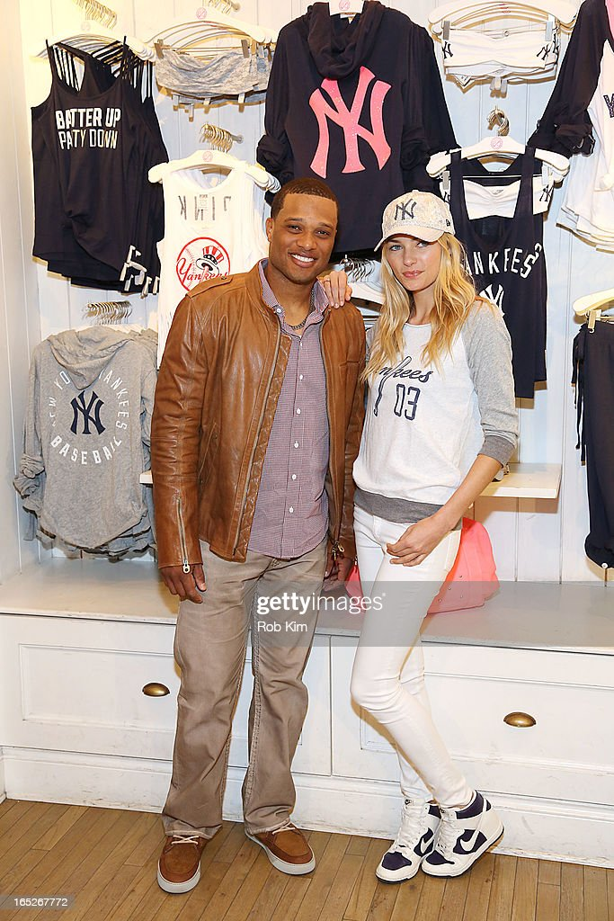 Robinson Cano and Jessica Hart celebrate opening day and the new MLB Pink Collection at Victoria's Secret PINK, Soho on April 2, 2013 in New York City.