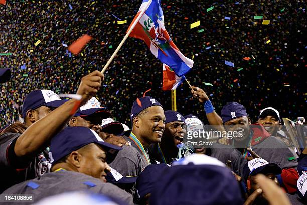 Robinson Cano and Jose Reyes of the Dominican Republic celebrate after defeating Puerto Rico to win the Championship Round of the 2013 World Baseball...