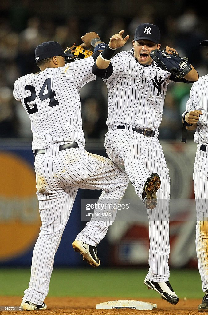 Robinson Cano and Nick Swisher of the New York Yankees celebrate after defeating the Chicago White Sox on April 30 2010 at Yankee Stadium in the...