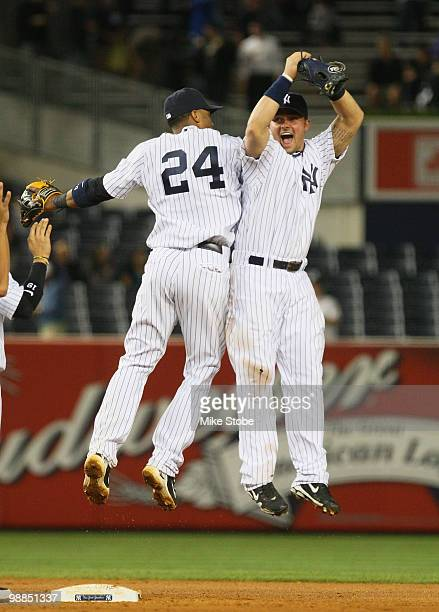 Robinson Cano and Nick Swisher of the New York Yankees celebrate after defeating the Baltimore Orioles 41 at Yankee Stadium on May 4 2010 in the...