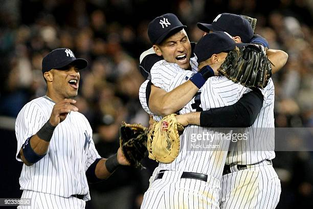 Robinson Cano Derek Jeter Mark Teixeira and Alex Rodriguez of the New York Yankees celebrate their 52 victory over the Los Angeles Angels of Anaheim...