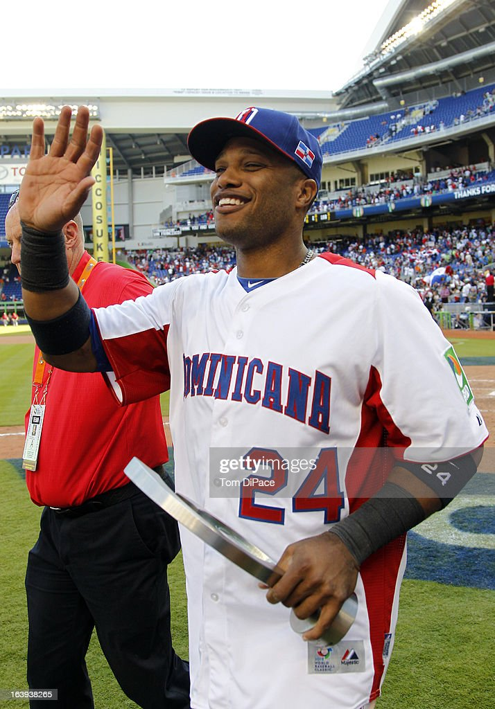 Robinson Cano #24 of Team Dominican Republic is seen with the second round MVP trophy on the field after Pool 2, Game 6 against Team Puerto Rico in the second round of the 2013 World Baseball Classic on Saturday, March 16, 2013 at Marlins Park in Miami, Florida.