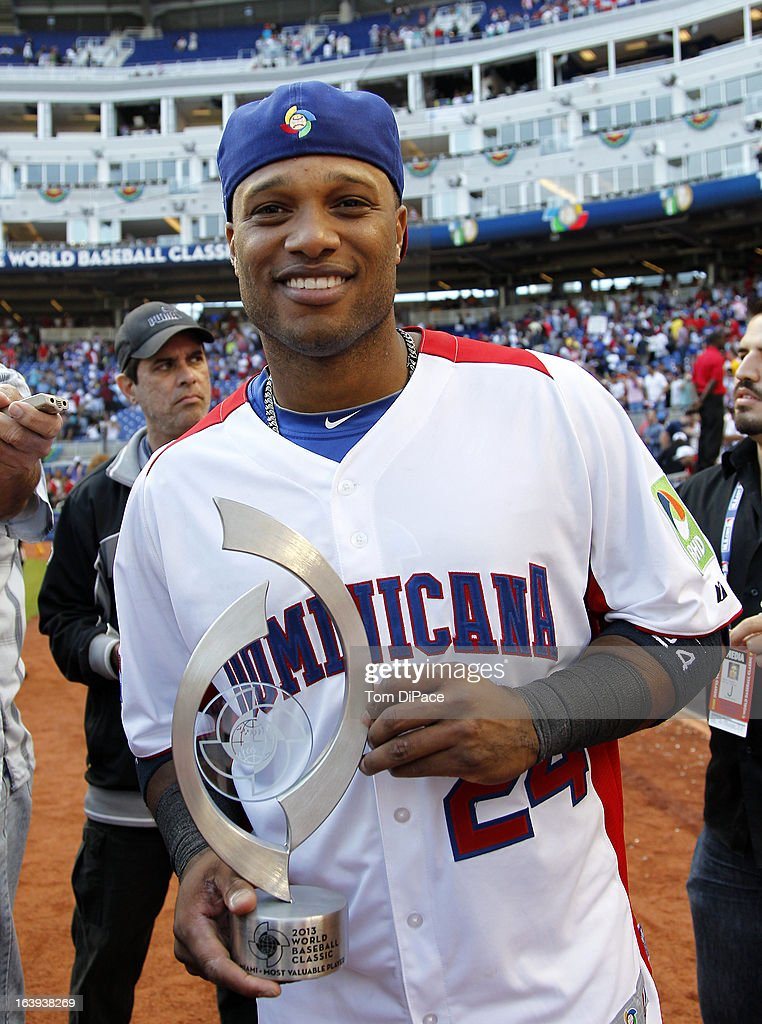 Robinson Cano #24 of Team Dominican Republic poses with the second round MVP trophy after Pool 2, Game 6 against Team Puerto Rico in the second round of the 2013 World Baseball Classic on Saturday, March 16, 2013 at Marlins Park in Miami, Florida.
