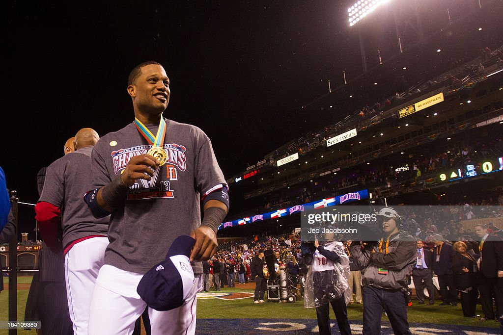 Robinson Cano #24 of Team Dominican Republic shows off his medal after winning the 2013 World Baseball Classic Championship Game against Team Puerto Rico on Tuesday, March 19, 2013 at AT&T Park in San Francisco, California.