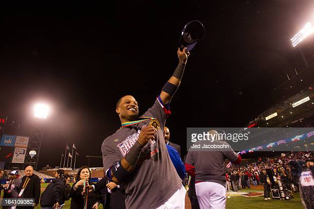 Robinson Cano of Team Dominican Republic shows off his medal after winning the 2013 World Baseball Classic Championship Game against Team Puerto Rico...