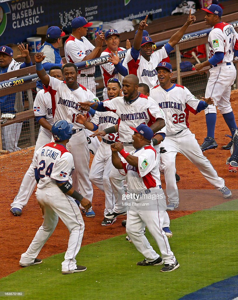 Robinson Cano #24 of the Dominican Republic celebrates after scoring the go ahead run a World Baseball Classic second round game against Italy at Marlins Park on March 12, 2013 in Miami, Florida.