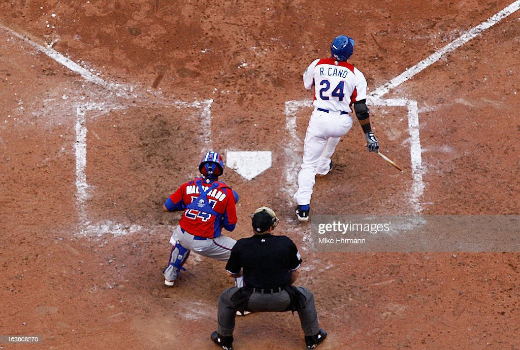 Robinson Cano #24 of the Dominican Republic hits an RBI double during a World Baseball Classic second round game against Puerto Rico at Marlins Park on March 16, 2013 in Miami, Florida.