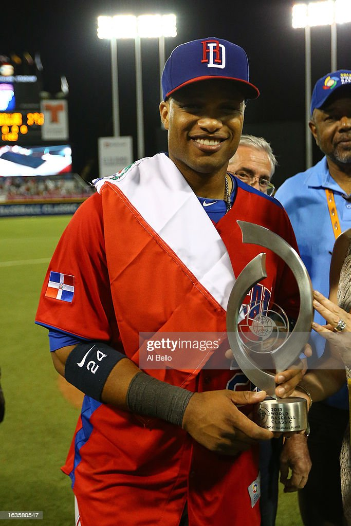 <a gi-track='captionPersonalityLinkClicked' href=/galleries/search?phrase=Robinson+Cano&family=editorial&specificpeople=538362 ng-click='$event.stopPropagation()'>Robinson Cano</a> #24 of the Dominican Republic holds the Most Valuable Player trophy for the tournament after their 4-2 win against Puerto Rico during the first round of the World Baseball Classic at Hiram Bithorn Stadium on March 10, 2013 in San Juan, Puerto Rico.