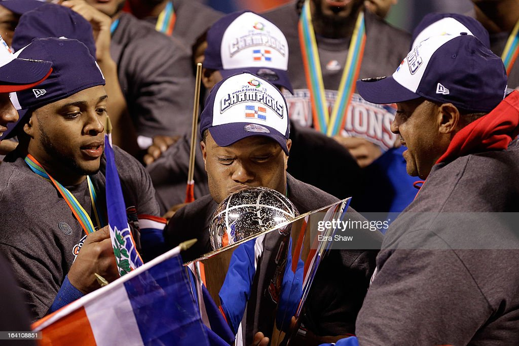 <a gi-track='captionPersonalityLinkClicked' href=/galleries/search?phrase=Robinson+Cano&family=editorial&specificpeople=538362 ng-click='$event.stopPropagation()'>Robinson Cano</a> #24 of the Dominican Republic kiss the trophy after defeating Puerto Rico to win the Championship Round of the 2013 World Baseball Classic by a score of 3-0 at AT&T Park on March 19, 2013 in San Francisco, California.