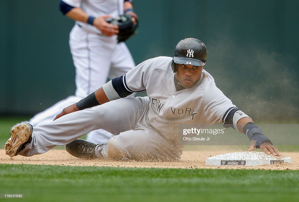 <a gi-track='captionPersonalityLinkClicked' href=/galleries/search?phrase=Robinson+Cano&family=editorial&specificpeople=538362 ng-click='$event.stopPropagation()'>Robinson Cano</a> #24 of the New York Yankees advances to second on a wild pitch in the eighth inning against the Seattle Mariners at Safeco Field on June 9, 2013 in Seattle, Washington.