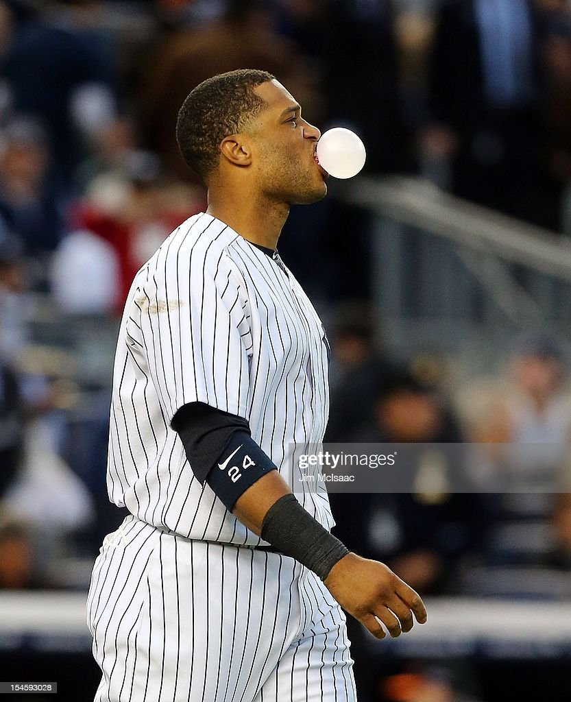 Robinson Cano #24 of the New York Yankees blows a bubble after striking out to end the fourth inning of Game Five of the American League Division Series against the Baltimore Orioles at Yankee Stadium on October 12, 2012 in the Bronx borough of New York City. The Yankees defeated the Orioles 3-1 to win their best of five series three games to two.