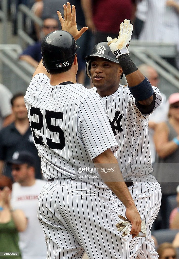 Robinson Cano #24 of the New York Yankees celebrates his fifth inning three run home run against the Chicago White Sox with teammate Mark Teixeira #25 on May 2, 2010 at Yankee Stadium in the Bronx borough of New York City. The Yankees defeated the White Sox 12-3.