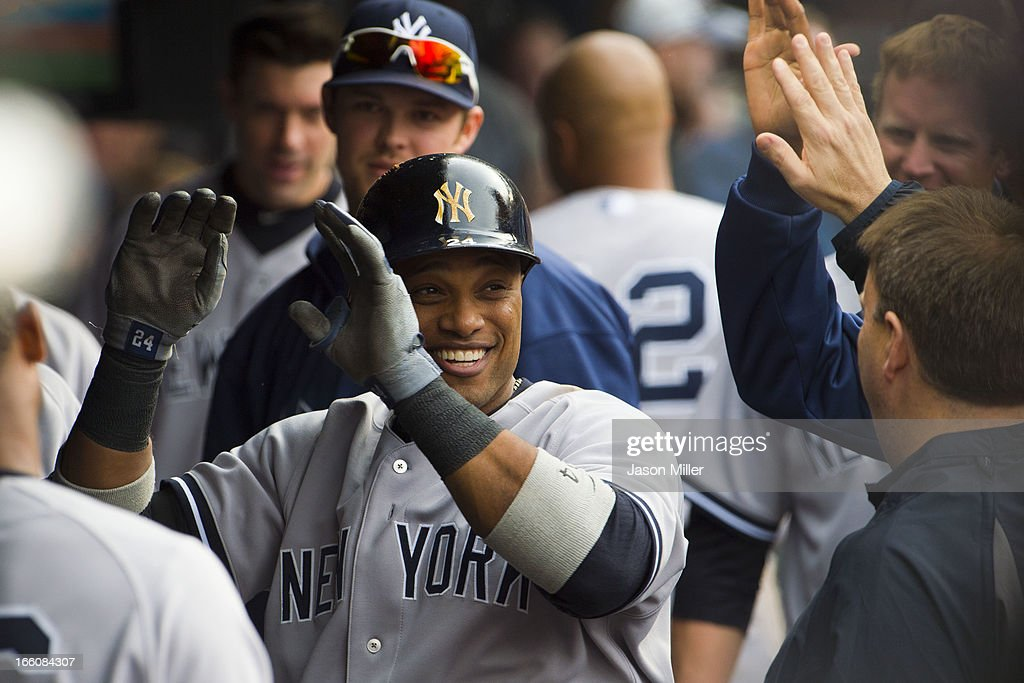 Robinson Cano #24 of the New York Yankees celebrates in the dugout after hitting a solo home run in the sixth inning against the Cleveland Indians on opening day at Progressive Field on April 8, 2013 in Cleveland, Ohio.