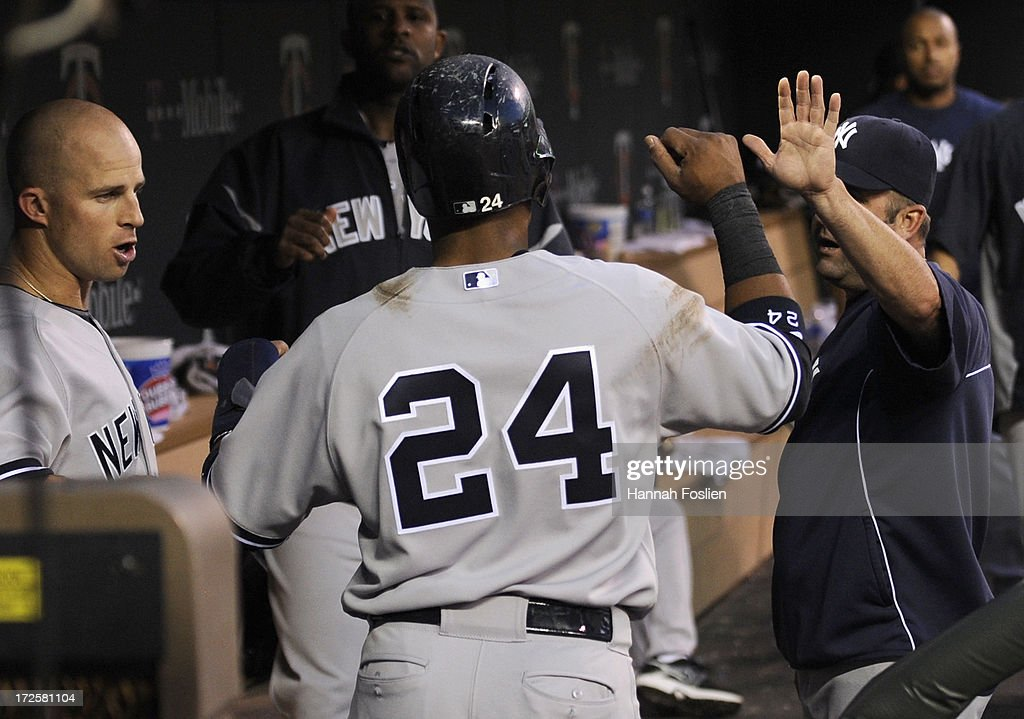 <a gi-track='captionPersonalityLinkClicked' href=/galleries/search?phrase=Robinson+Cano&family=editorial&specificpeople=538362 ng-click='$event.stopPropagation()'>Robinson Cano</a> #24 of the New York Yankees celebrates scoring against the Minnesota Twins during the sixth inning of the game on July 3, 2013 at Target Field in Minneapolis, Minnesota.