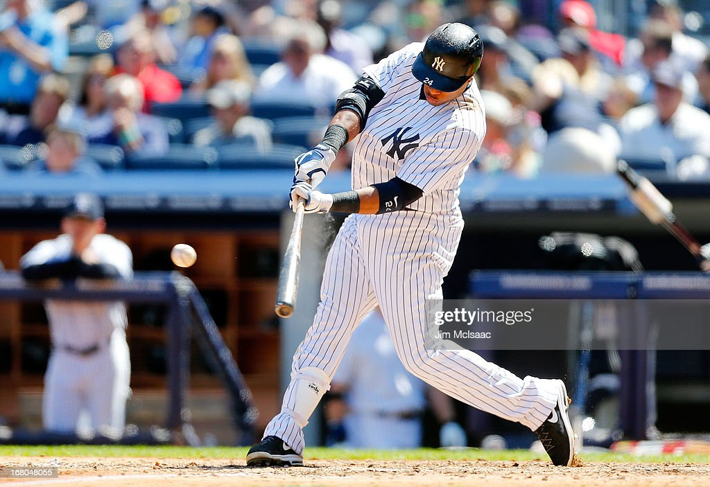 Robinson Cano #24 of the New York Yankees connects on a sixth inning double against the Oakland Athletics at Yankee Stadium on May 4, 2013 in the Bronx borough of New York City.