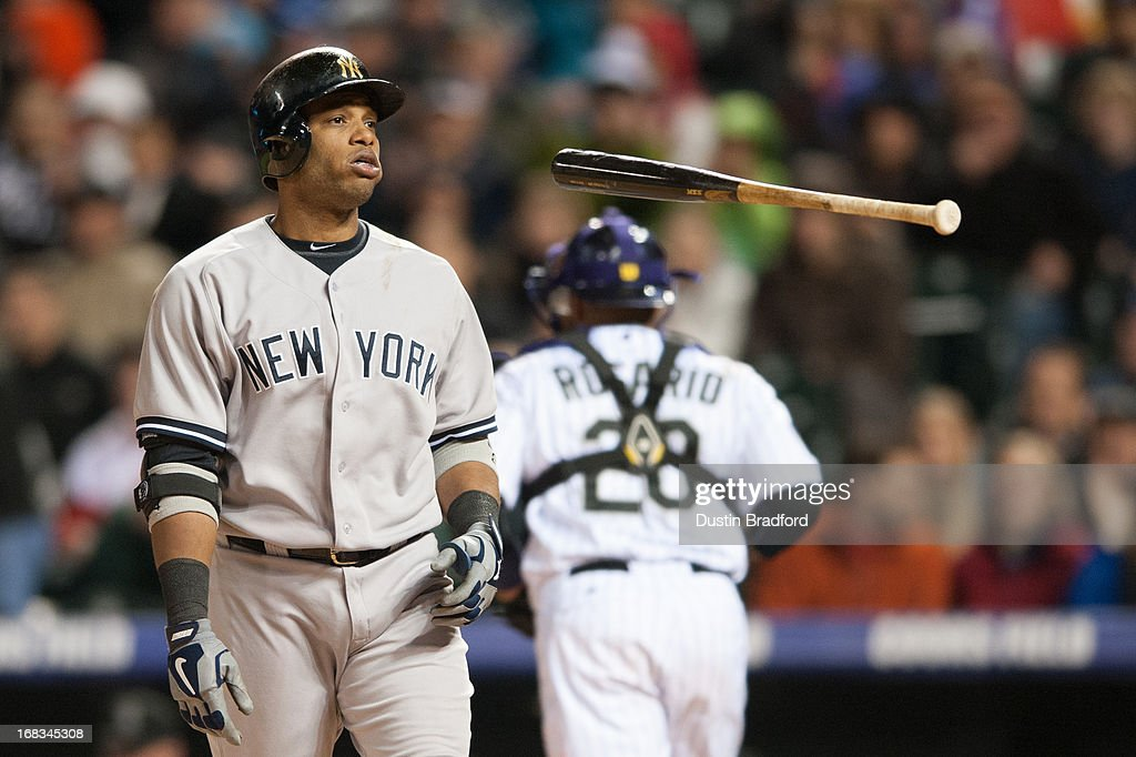 Robinson Cano #24 of the New York Yankees flips his bat after striking out to end the eighth inning of a game against the Colorado Rockies at Coors Field on May 8, 2013 in Denver, Colorado. The Yankees beat the Rockies 3-2.