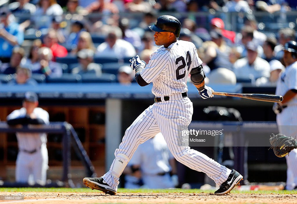 Robinson Cano #24 of the New York Yankees follows through on a sixth inning double against the Oakland Athletics at Yankee Stadium on May 4, 2013 in the Bronx borough of New York City.