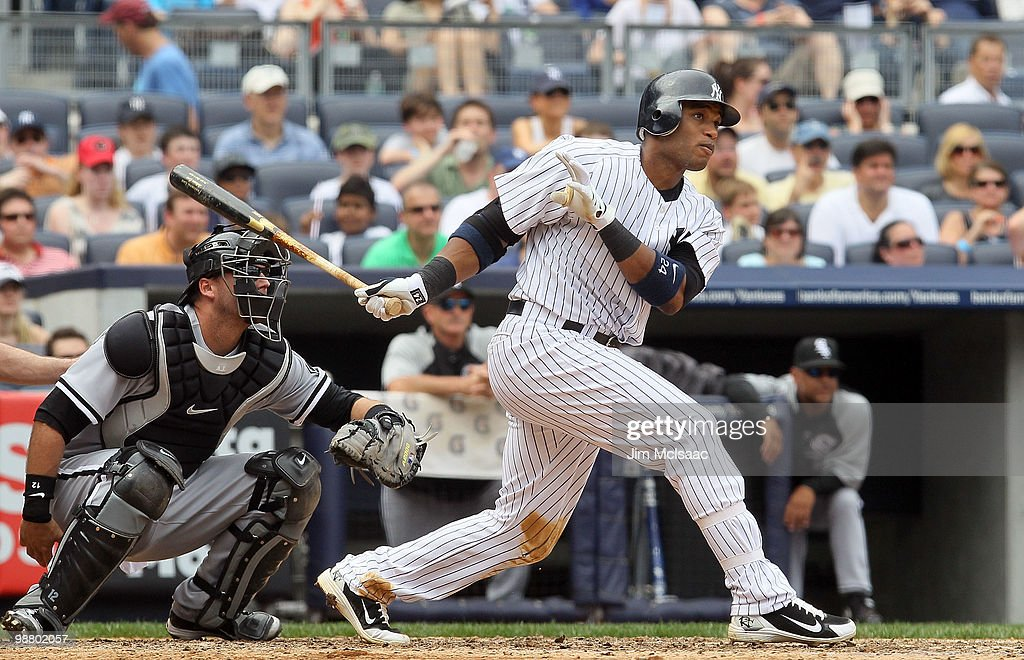 <a gi-track='captionPersonalityLinkClicked' href=/galleries/search?phrase=Robinson+Cano&family=editorial&specificpeople=538362 ng-click='$event.stopPropagation()'>Robinson Cano</a> #24 of the New York Yankees follows through on his fifth inning three run home run against the Chicago White Sox on May 2, 2010 at Yankee Stadium in the Bronx borough of New York City. The Yankees defeated the White Sox 12-3.