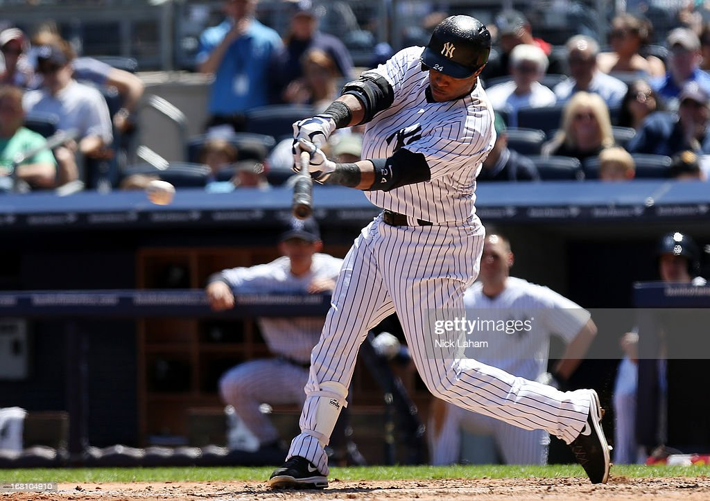 Robinson Cano #24 of the New York Yankees hits a RBI to drive in Brett Gardner #11 against the Oakland Athletics at Yankee Stadium on May 5, 2013 in the Bronx borough of New York City.