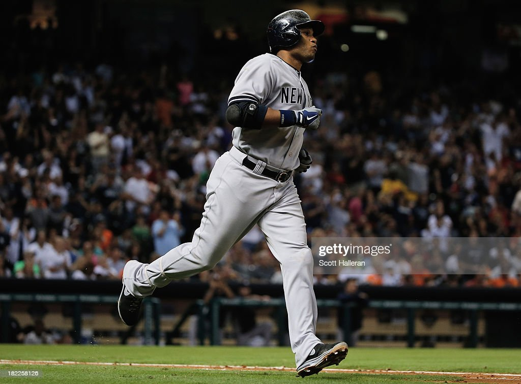 Robinson Cano #24 of the New York Yankees hits a single in the sixth inning against the Houston Astros at Minute Maid Park on September 28, 2013 in Houston, Texas.