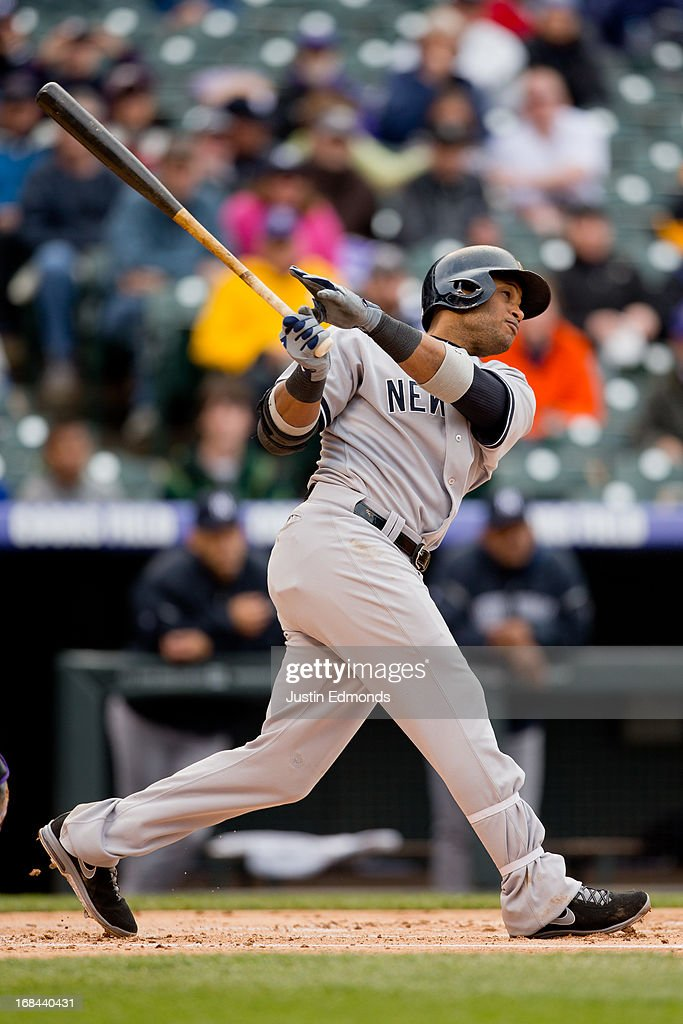 <a gi-track='captionPersonalityLinkClicked' href=/galleries/search?phrase=Robinson+Cano&family=editorial&specificpeople=538362 ng-click='$event.stopPropagation()'>Robinson Cano</a> #24 of the New York Yankees hits a solo home run during the fifth inning against the Colorado Rockies at Coors Field on May 9, 2013 in Denver, Colorado. The Yankees defeated the Rockies 3-1 to win the series.