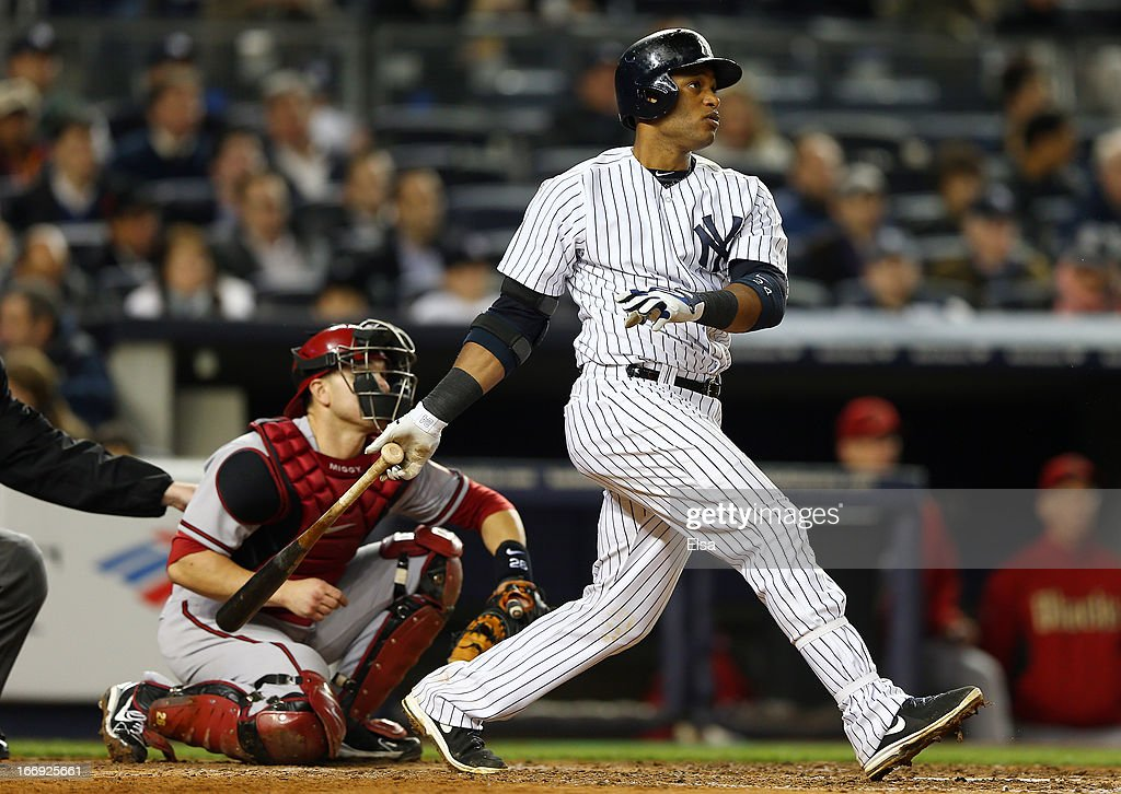 Robinson Cano #24 of the New York Yankees hits a solo home run in the sixth inning as Miguel Montero #26 of the Arizona Diamondbacks catches on April 18, 2013 at Yankee Stadium in the Bronx borough of New York City.