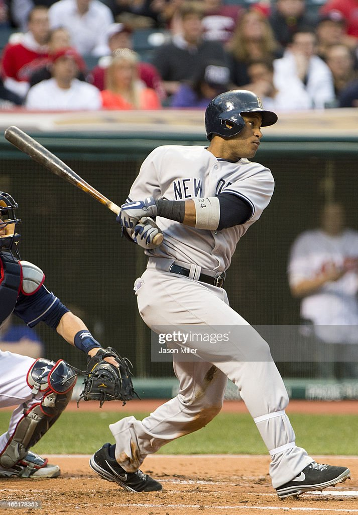 Robinson Cano #24 of the New York Yankees hits a two RBI double to deep right during the second inning against the Cleveland Indians at Progressive Field on April 9, 2013 in Cleveland, Ohio.