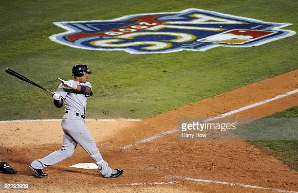 Robinson Cano of the New York Yankees hits a two run triple to right field during the seventh inning in Game Five of the ALCS against the Los Angeles...