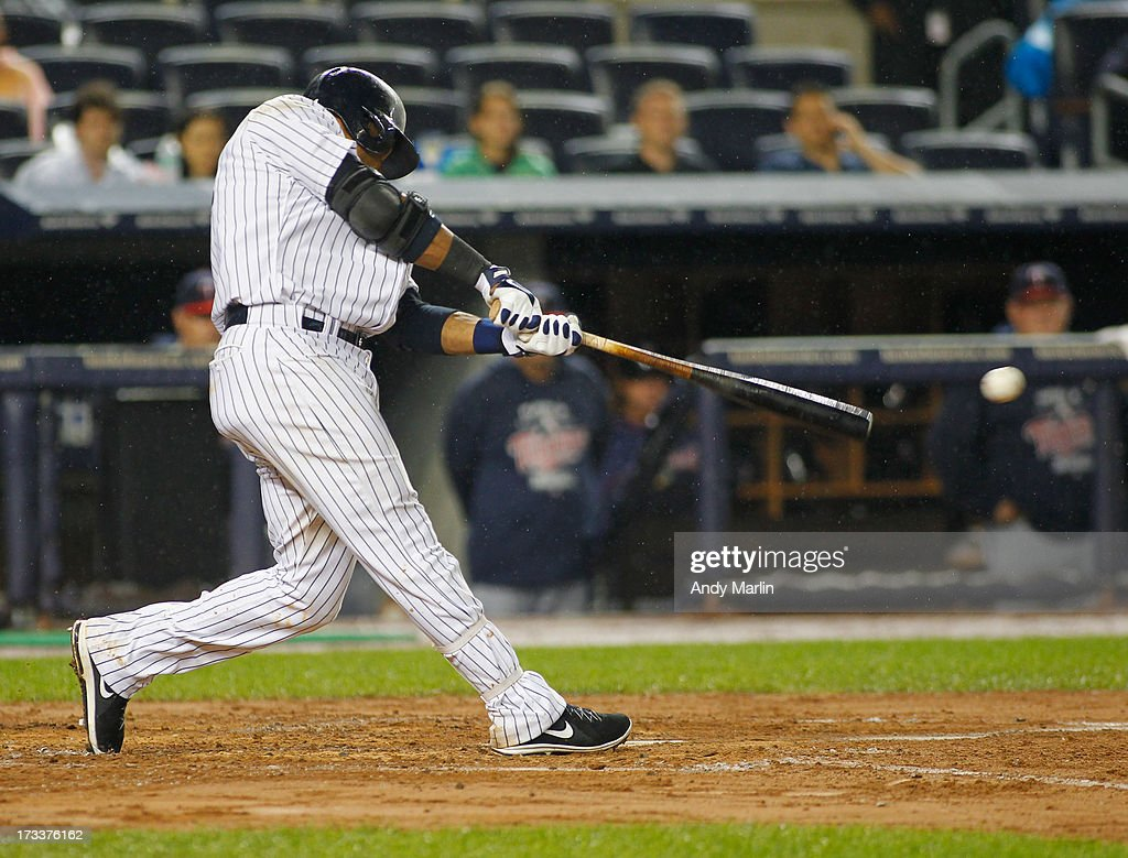 <a gi-track='captionPersonalityLinkClicked' href=/galleries/search?phrase=Robinson+Cano&family=editorial&specificpeople=538362 ng-click='$event.stopPropagation()'>Robinson Cano</a> #24 of the New York Yankees hits an RBI single in the bottom of the fifth inning against the Minnesota Twins at Yankee Stadium on July 12, 2013 in the Bronx borough of New York City.