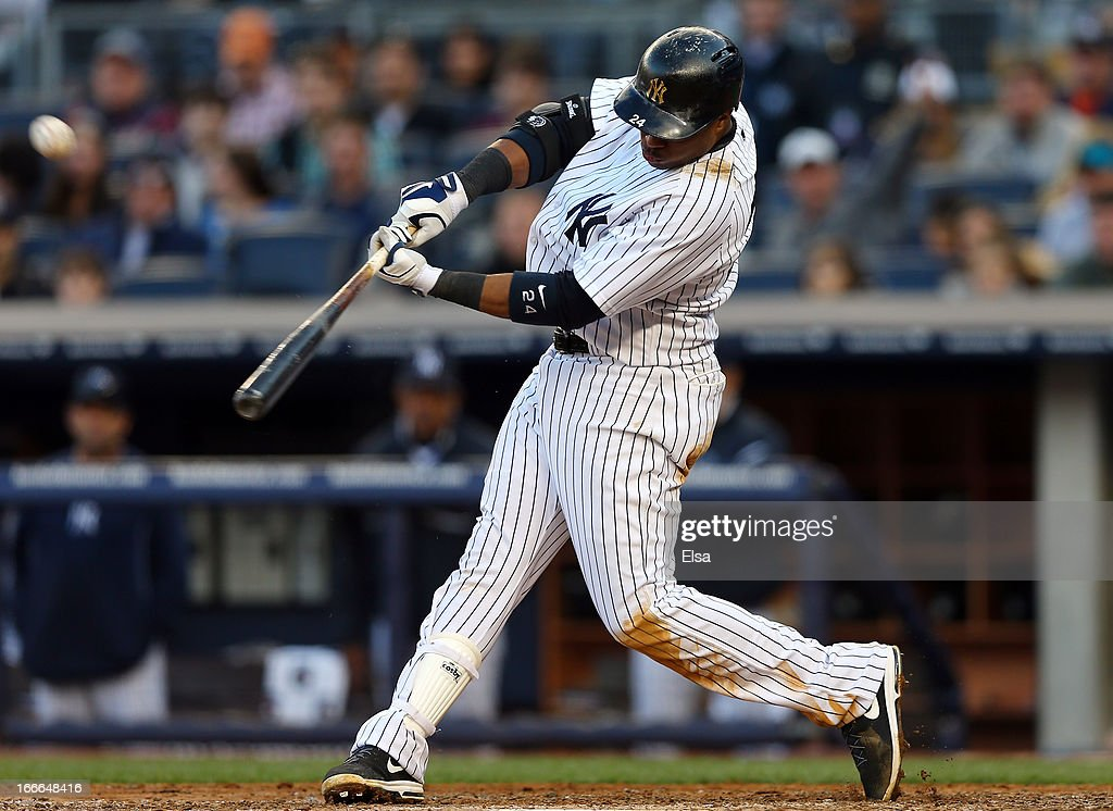 <a gi-track='captionPersonalityLinkClicked' href=/galleries/search?phrase=Robinson+Cano&family=editorial&specificpeople=538362 ng-click='$event.stopPropagation()'>Robinson Cano</a> #24 of the New York Yankees hits the ball against the Baltimore Orioles on April 13, 2013 at Yankee Stadium in the Bronx borough of New York City.The Baltimore Orioles defeated the New York Yankees 5-3.