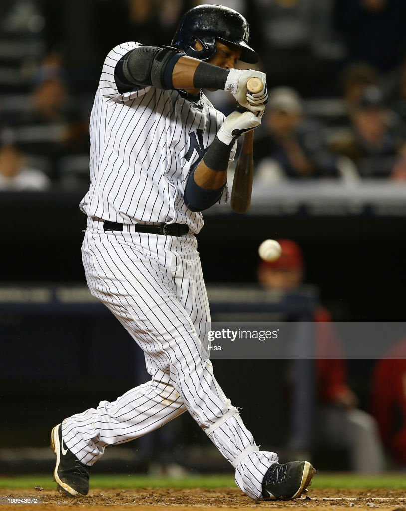 Robinson Cano #24 of the New York Yankees is called out on this swing with the bases loaded against the Arizona Diamondbacks on April 18, 2013 at Yankee Stadium in the Bronx borough of New York City.The Arizona Diamondbacks defeated the New York Yankees 6-2 in 12 innings.