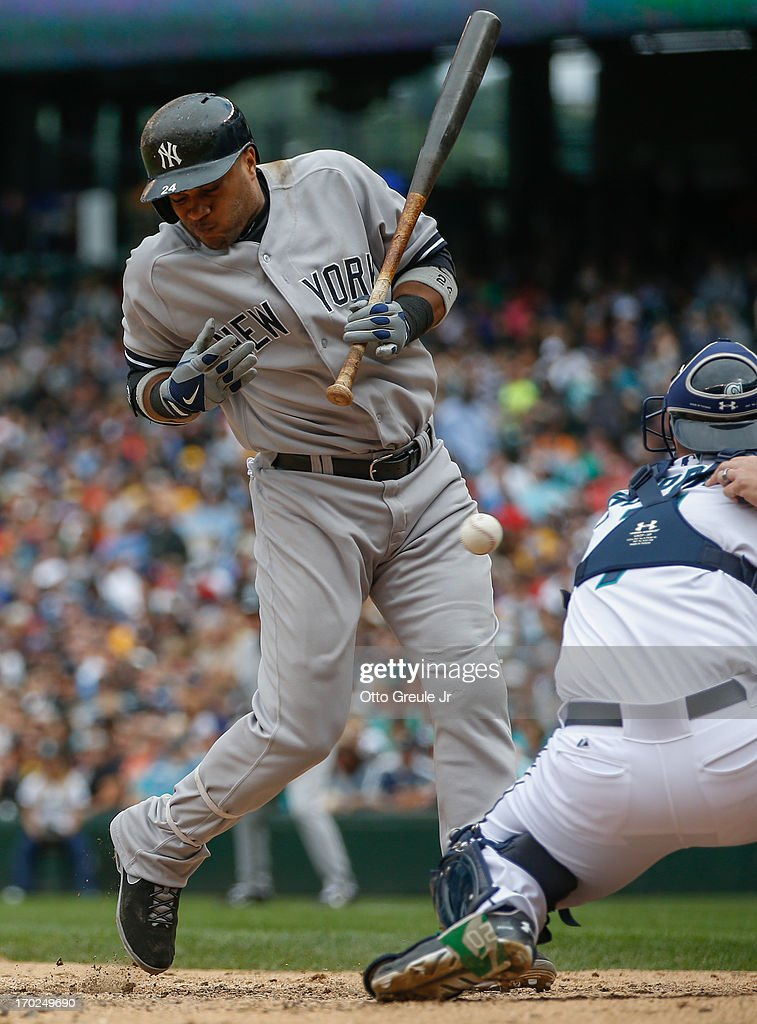 <a gi-track='captionPersonalityLinkClicked' href=/galleries/search?phrase=Robinson+Cano&family=editorial&specificpeople=538362 ng-click='$event.stopPropagation()'>Robinson Cano</a> #24 of the New York Yankees is hit by a pitch in the eighth inning against the Seattle Mariners at Safeco Field on June 9, 2013 in Seattle, Washington. The Yankees defeated the Mariners 2-1.