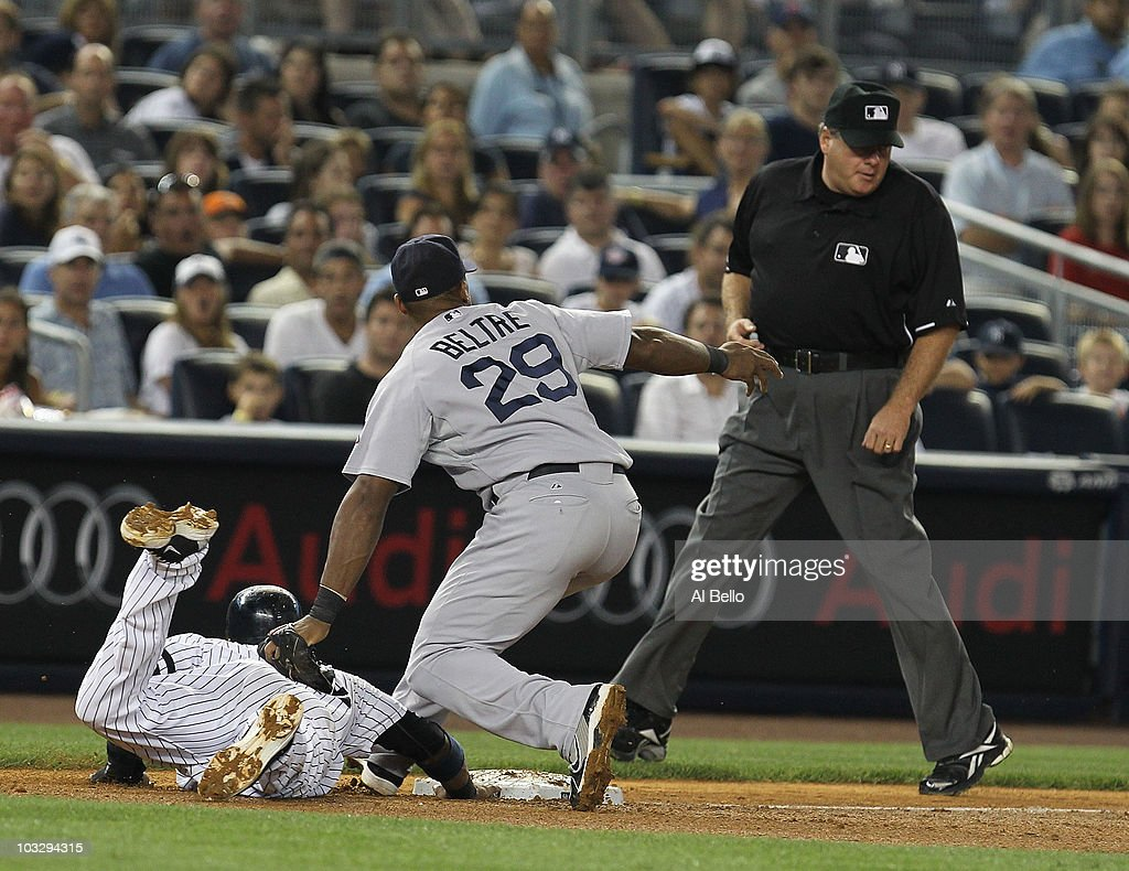 <a gi-track='captionPersonalityLinkClicked' href=/galleries/search?phrase=Robinson+Cano&family=editorial&specificpeople=538362 ng-click='$event.stopPropagation()'>Robinson Cano</a> #24 of the New York Yankees is safe at third and would go on to score on a wild throw by Kevin Cash of the Boston Red Sox as <a gi-track='captionPersonalityLinkClicked' href=/galleries/search?phrase=Adrian+Beltre&family=editorial&specificpeople=202631 ng-click='$event.stopPropagation()'>Adrian Beltre</a> #29 looks on in the fifth inning during their game on August 8, 2010 at Yankee Stadium in the Bronx borough of New York City.