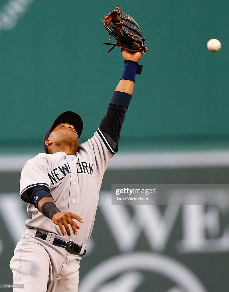 <a gi-track='captionPersonalityLinkClicked' href=/galleries/search?phrase=Robinson+Cano&family=editorial&specificpeople=538362 ng-click='$event.stopPropagation()'>Robinson Cano</a> #24 of the New York Yankees jumps up but cannot catch a line drive against the Boston Red Sox during the game on July 20, 2013 at Fenway Park in Boston, Massachusetts.