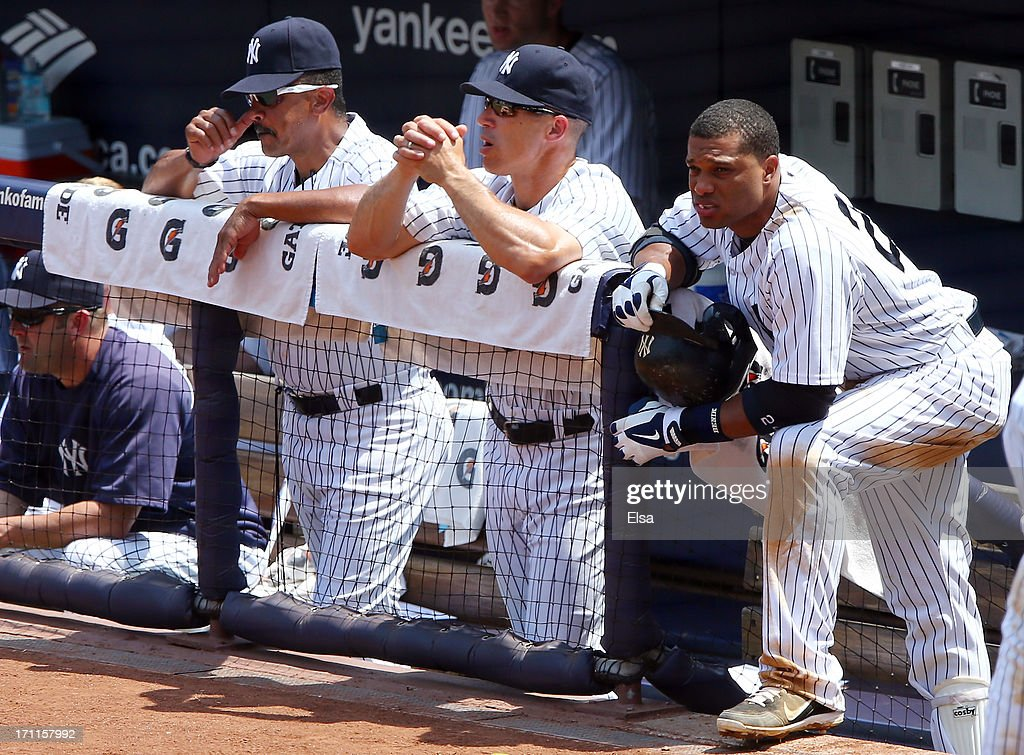 <a gi-track='captionPersonalityLinkClicked' href=/galleries/search?phrase=Robinson+Cano&family=editorial&specificpeople=538362 ng-click='$event.stopPropagation()'>Robinson Cano</a> #24 of the New York Yankees looks on from the dugout during the game against the Tampa Bay Rays on June 22,2013 at Yankee Stadium in the Bronx borough of New York City.
