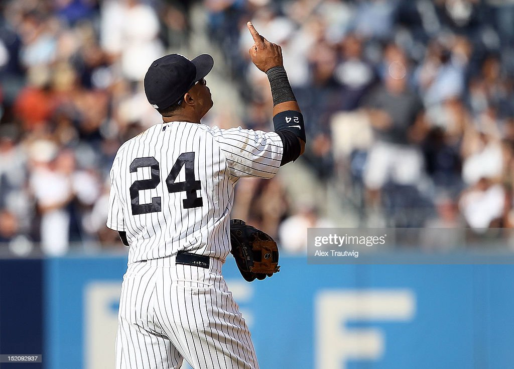 <a gi-track='captionPersonalityLinkClicked' href=/galleries/search?phrase=Robinson+Cano&family=editorial&specificpeople=538362 ng-click='$event.stopPropagation()'>Robinson Cano</a> #24 of the New York Yankees reacts after the Yankees defeated the Tampa Bay Rays at Yankee Stadium on September 16, 2012 in the Bronx borough of New York City.