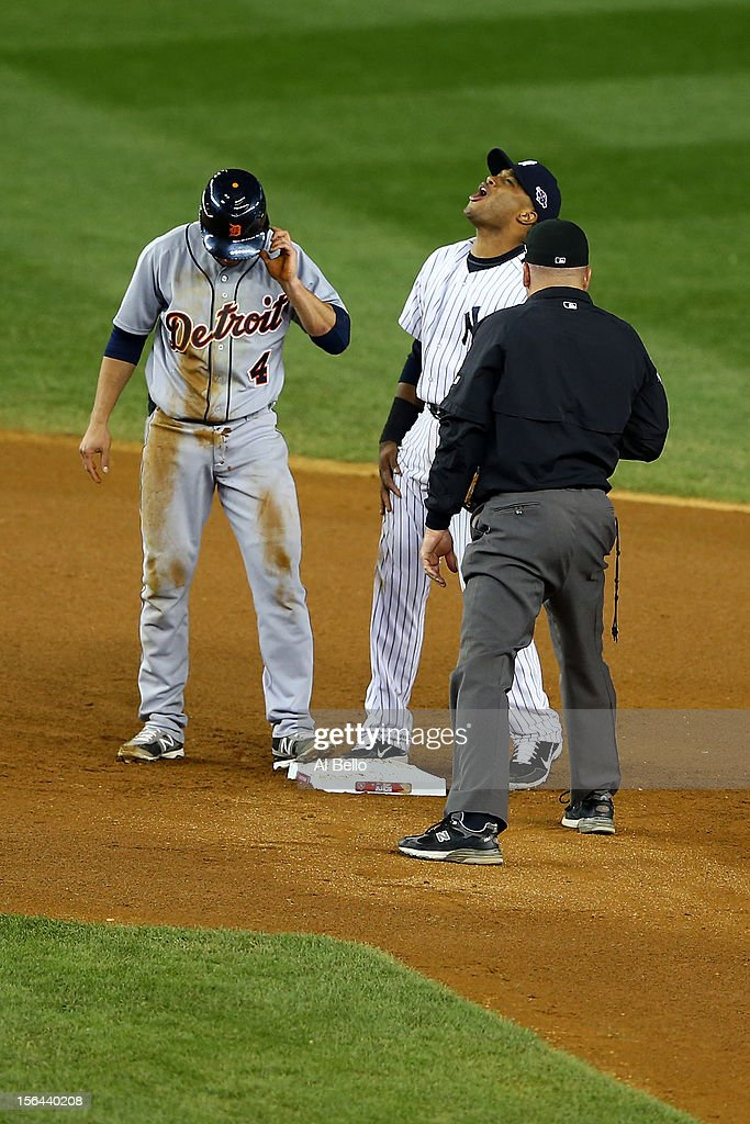 Robinson Cano #24 of the New York Yankees reacts after umpire Jeff Nelson called Omar Infante #4 of the Detroit Tigers safe as he dove back into second base in the top of the eighth inning during Game Two of the American League Championship Series at Yankee Stadium on October 14, 2012 in the Bronx borough of New York City.