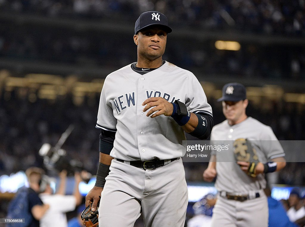 <a gi-track='captionPersonalityLinkClicked' href=/galleries/search?phrase=Robinson+Cano&family=editorial&specificpeople=538362 ng-click='$event.stopPropagation()'>Robinson Cano</a> #24 of the New York Yankees reacts as he leaves the infield after a Mark Ellis #14 of the Los Angeles Dodgers hit to score Andre Ethier #16 for the game winning run and a 3-2 victory during the ninth inning at Dodger Stadium on July 30, 2013 in Los Angeles, California.