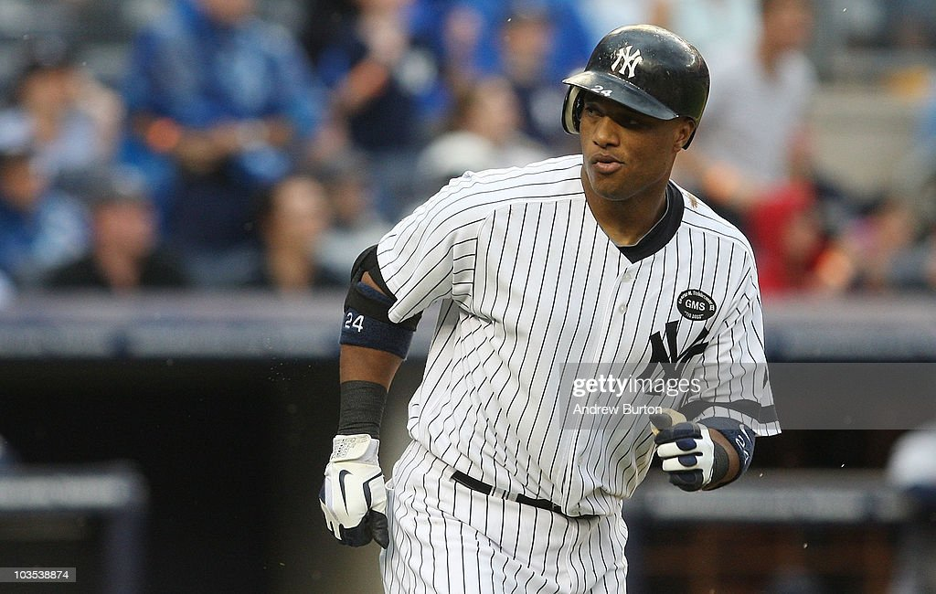 <a gi-track='captionPersonalityLinkClicked' href=/galleries/search?phrase=Robinson+Cano&family=editorial&specificpeople=538362 ng-click='$event.stopPropagation()'>Robinson Cano</a> #24 of the New York Yankees reacts to his grand slam home run against the Seattle Mariners in the fifth inning on August 22, 2010 at Yankee Stadium in the Bronx borough of New York City.