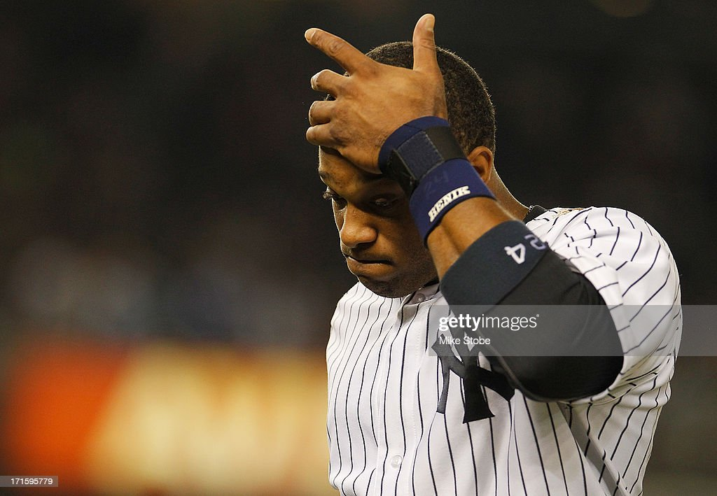 <a gi-track='captionPersonalityLinkClicked' href=/galleries/search?phrase=Robinson+Cano&family=editorial&specificpeople=538362 ng-click='$event.stopPropagation()'>Robinson Cano</a> #24 of the New York Yankees reatcs at the end of the seventh inning against the Texas Rangers at Yankee Stadium on June 26, 2013 in the Bronx borough of New York City. Rangers defeated the Yankees 8-5.