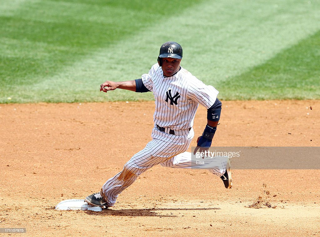 <a gi-track='captionPersonalityLinkClicked' href=/galleries/search?phrase=Robinson+Cano&family=editorial&specificpeople=538362 ng-click='$event.stopPropagation()'>Robinson Cano</a> #24 of the New York Yankees rounds second base during the game against the Tampa Bay Rays on June 22,2013 at Yankee Stadium in the Bronx borough of New York City.