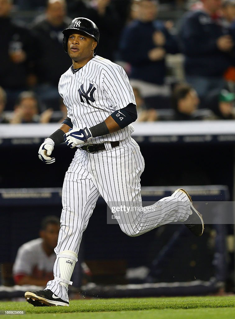 Robinson Cano #24 of the New York Yankees rounds the bases after his solo home run in the sixth inning as Miguel Montero #26 of the Arizona Diamondbacks catches on April 18, 2013 at Yankee Stadium in the Bronx borough of New York City.